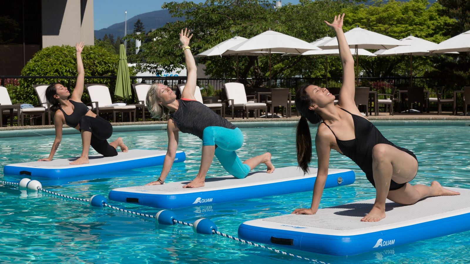 Experience a liquid yoga class at The Westin Bayshore, Vancouver hotel pool this summer.